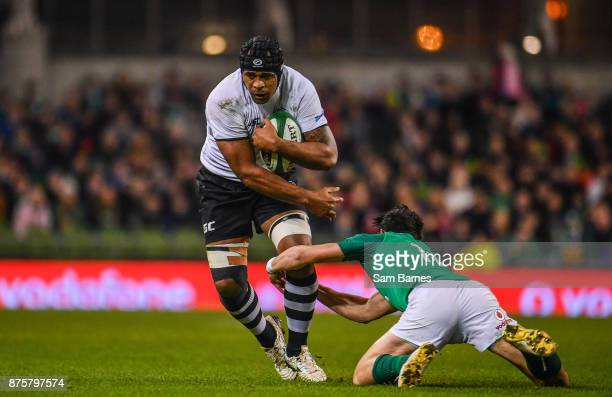 Dublin Ireland 18 November 2017 Akapusi Qera of Fiji is tackled by Joey Carbery of Ireland during the Guinness Series International match between...