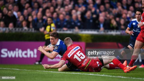 Dublin Ireland 19 May 2017 Garry Ringrose of Leinster goes over to score his side's first try despite the attention of Johnny McNicholl of Scarlets...