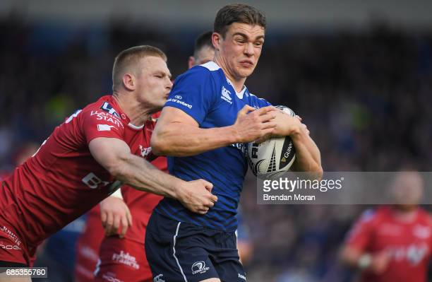 Dublin Ireland 19 May 2017 Garry Ringrose of Leinster is tackled by Johnny McNicholl of Scarlets on the way to scoring his side's first try during...