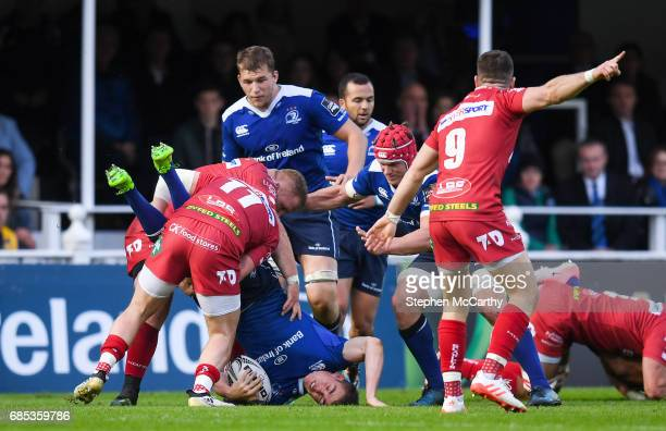 Dublin Ireland 19 May 2017 Garry Ringrose of Leinster is tackled by Steff Evans of Scarlets during the Guinness PRO12 SemiFinal match between...