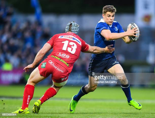 Dublin Ireland 19 May 2017 Garry Ringrose of Leinster is tackled by Jonathan Davies of Scarlets during the Guinness PRO12 SemiFinal match between...