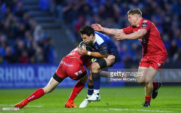 Dublin Ireland 19 May 2017 Joey Carbery of Leinster is tackled by Johnny McNicholl left and James Davies of Scarlets during the Guinness PRO12...