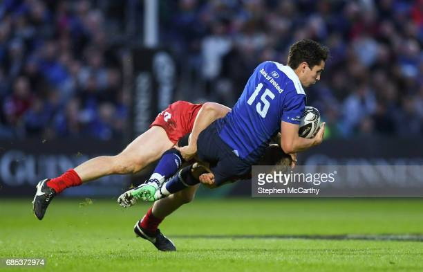 Dublin Ireland 19 May 2017 Joey Carbery of Leinster is tackled by James Davies of Scarlets during the Guinness PRO12 SemiFinal match between Leinster...