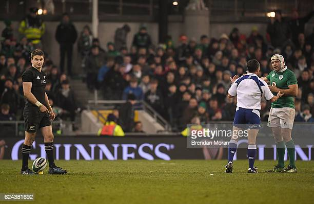 Dublin Ireland 19 November 2016 Ireland captain Rory Best right questions a decision by referee Jaco Peyper as Beauden Barrett of New Zealand...
