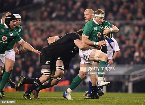 Dublin Ireland 19 November 2016 Jamie Heaslip of Ireland is tackled by Liam Squire of New Zealand during the Autumn International match between...