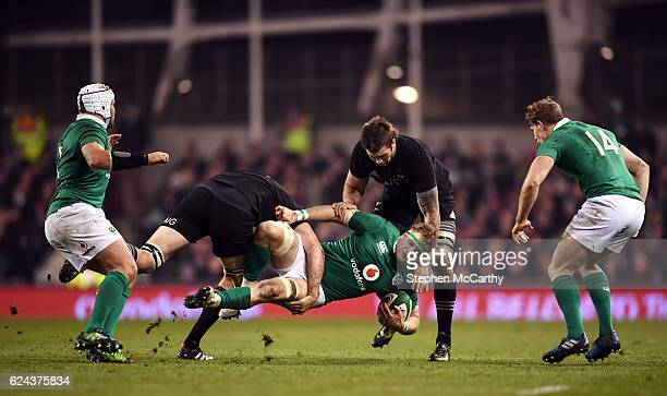 Dublin Ireland 19 November 2016 Jamie Heaslip of Ireland is tackled by Liam Squire right and Brodie Retallick of New Zealand during the Autumn...