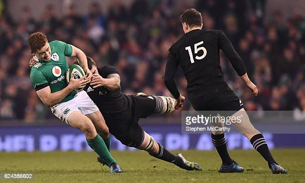 Dublin Ireland 19 November 2016 Paddy Jackson of Ireland is tackled by Liam Squire of New Zealand during the Autumn International match between...