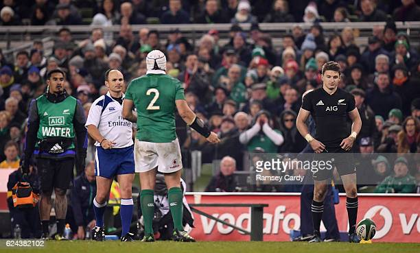 Dublin Ireland 19 November 2016 Rory Best of Ireland speaks to referee Jaco Peyper while Beauden Barrett of New Zealand prepares to kick a conversion...
