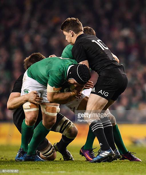 Dublin Ireland 19 November 2016 Sean OBrien of Ireland is tackled by Liam Squire left and Beauden Barrett of New Zealand during the Autumn...