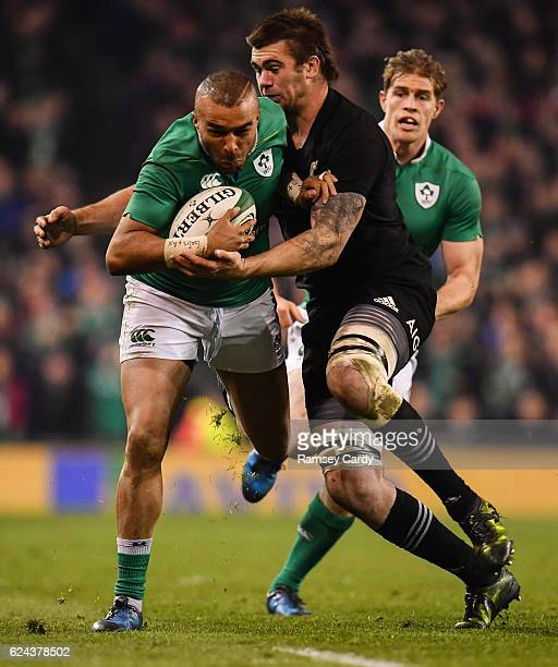 Dublin Ireland 19 November 2016 Simon Zebo of Ireland is tackled by Liam Squire of New Zealand during the Autumn International match between Ireland...