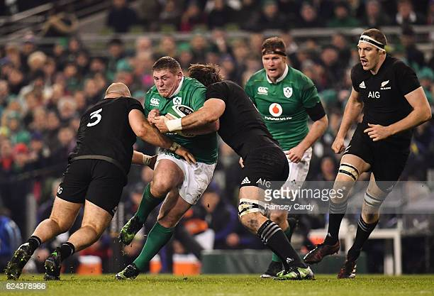 Dublin Ireland 19 November 2016 Tadhg Furlong of Ireland is tackled by Owen Franks left and Liam Squire of New Zealand during the Autumn...