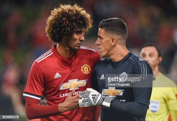 Dublin Ireland 2 August 2017 Marouane Fellaini left and Joel Pereira of Manchester United following the International Champions Cup match between...