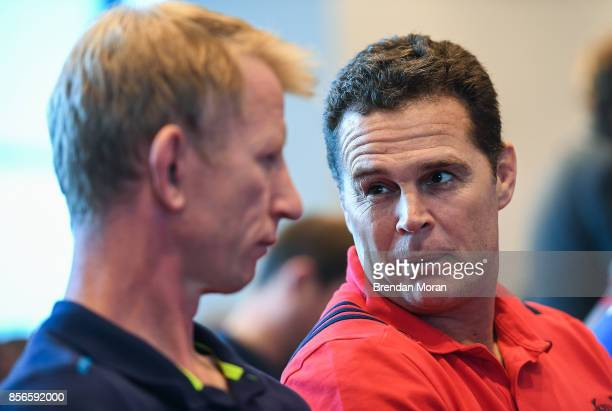 Dublin Ireland 2 October 2017 Munster head coach Rassie Erasmus in conversation with Leinster head coach Leo Cullen at the European Rugby Champions...