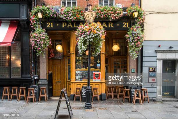 Dublin, Ireland. 21 August 2017. View of the Palace Bar with hanging baskets and stools in the Temple Bar area of Dublin, Southern Ireland.