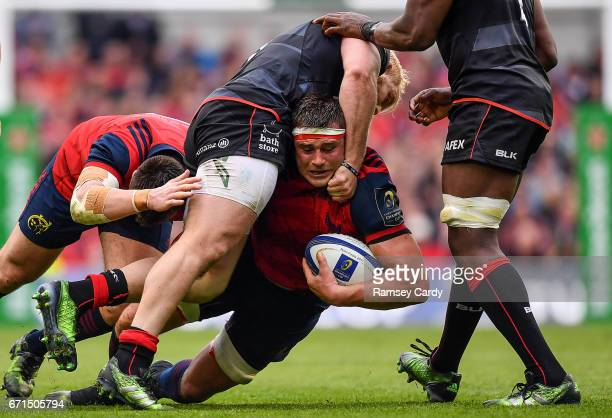 Dublin Ireland 22 April 2017 CJ Stander of Munster is tackled by Vincent Koch of Saracens during the European Rugby Champions Cup SemiFinal match...