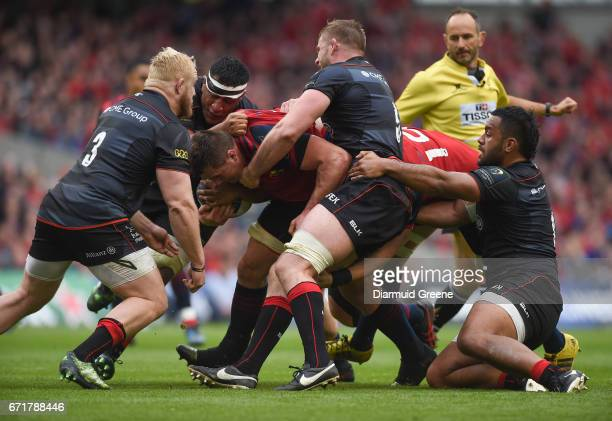 Dublin Ireland 22 April 2017 CJ Stander of Munster is tackled by Vincent Koch Mako Vunipola George Kruis and Billy Vunipola of Saracens during the...