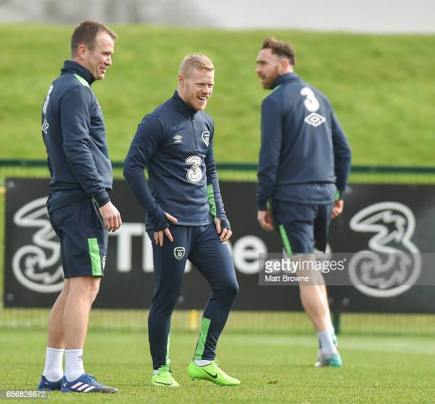 Dublin Ireland 23 March 2017 Daryl Horgan centre of the Republic of Ireland with his teammates Glenn Whelan left and Richard Keogh during squad...