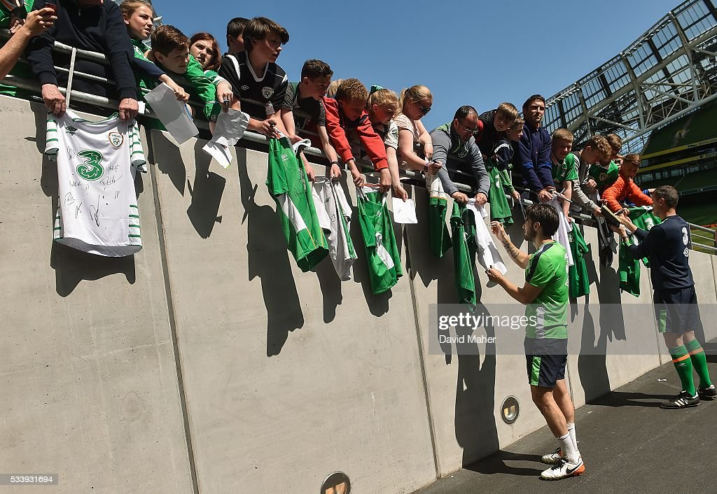 Dublin , Ireland - 24 May 2016; Harry Arter, left, of the Republic of Ireland and assistant manager Roy Keane, sign autographs for supporters after squad training in the Aviva Stadium, Lansdowne Road, Dublin.