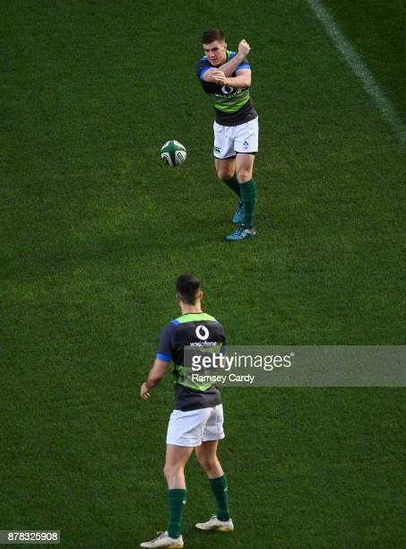 Dublin Ireland 24 November 2017 Luke McGrath above and Conor Murray during Ireland rugby captain's run at the Aviva Stadium in Dublin
