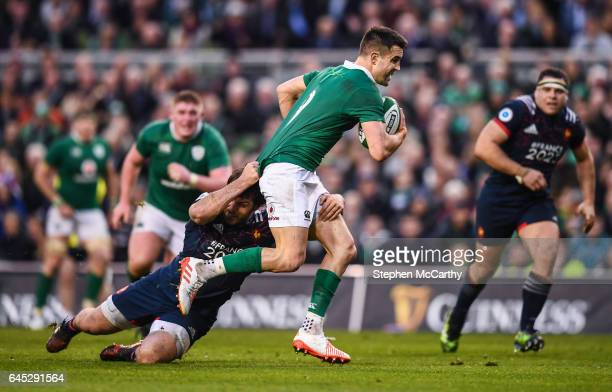 Dublin Ireland 25 February 2017 Conor Murray of Ireland is tackled by Kevin Gourdon of France during the RBS Six Nations Rugby Championship game...