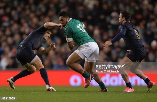 Dublin Ireland 25 November 2017 Bundee Aki of Ireland in action against Nicolas Sanchez left and Martin Landajo of Argentina during the Guinness...
