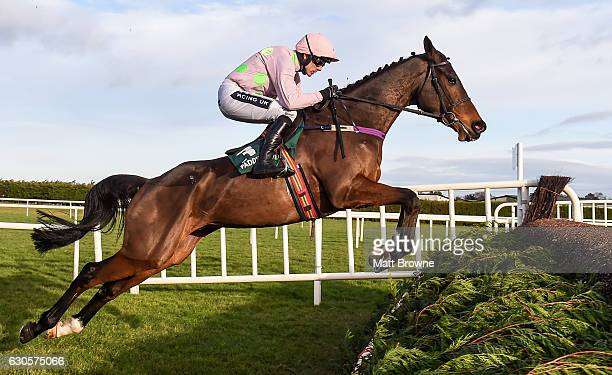 Dublin Ireland 27 December 2016 Douvan with Ruby Walsh up jumps the second on their way to winning the Paddy Power Cashcard Steeplechase during day...