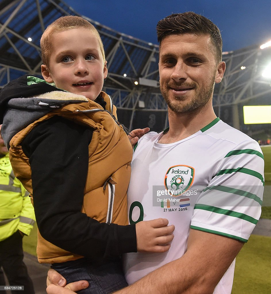Dublin , Ireland - 27 May 2016; <a gi-track='captionPersonalityLinkClicked' href=/galleries/search?phrase=Shane+Long&family=editorial&specificpeople=661194 ng-click='$event.stopPropagation()'>Shane Long</a> of Republic of Ireland with Calum Fennessy Byrne, age 5, from Gorthnaoe, Co.Tipperay, at the end of the 3 International Friendly between Republic of Ireland and Netherlands in the Aviva Stadium, Lansdowne Road, Dublin.