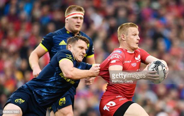 Dublin Ireland 27 May 2017 Johnny McNicholl of Scarlets is tackled by Rory Scannell of Munster during the Guinness PRO12 Final between Munster and...