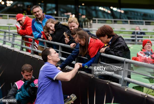 Dublin Ireland 27 May 2017 Munster director of rugby Rassie Erasmus with Jennifer Malone from Clane Co Kildare ahead of the Guinness PRO12 Final...