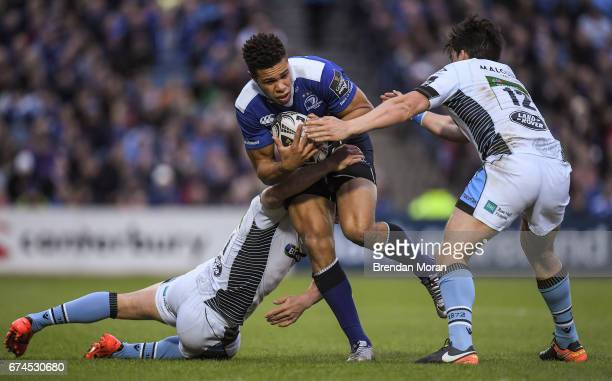 Dublin Ireland 28 April 2017 Adam Byrne of Leinster is tackled by Lee Jones left and Sam Johnson of Glasgow Warriors during the Guinness PRO12 Round...