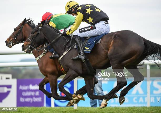 Dublin Ireland 28 April 2017 Bacardys right with Patrick Mullins up races Finian's Oscar who finished second with Robbie Power up on their way to...