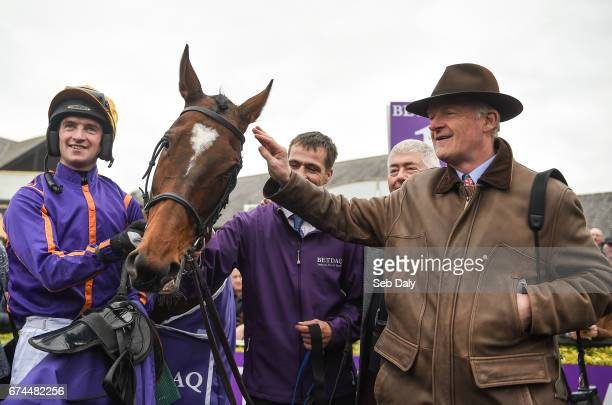 Dublin Ireland 28 April 2017 Jockey Patrick Mullins left and trainer Willie Mullins right with Wicklow Brave after winning the BETDAQ Punchestown...