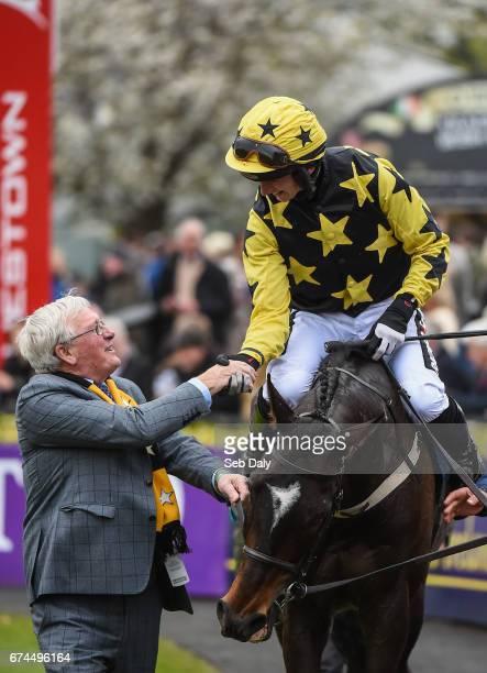 Dublin Ireland 28 April 2017 Jockey Patrick Mullins shakes hands with owner Pat McSweeney after winning the Tattersalls Ireland Champion Novice...