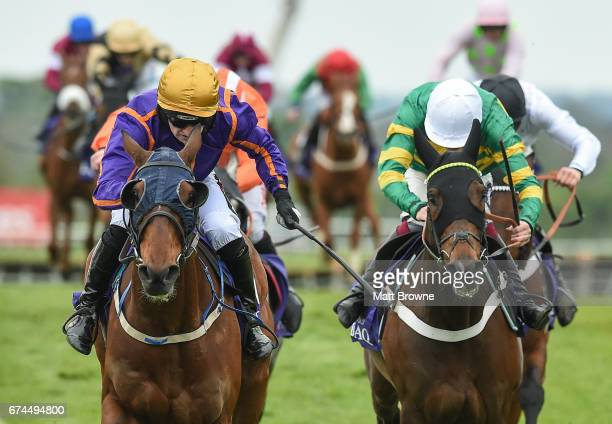 Dublin Ireland 28 April 2017 Wicklow Brave left with Patrick Mullins up alongside third place My Tent Or Yours with Aidan Coleman up on their way to...
