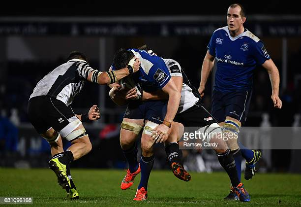 Dublin Ireland 6 January 2017 Jack Conan of Leinster is tackled by Andries Van Schalkwyk left and Andrea Lovotti of Zebre during the Guinness PRO12...