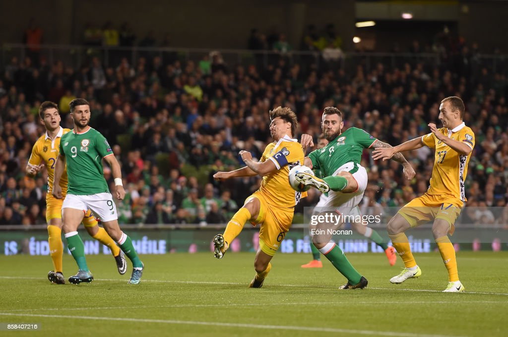 Dublin , Ireland - 6 October 2017; Daryl Murphy of Republic of Ireland shoots to score his side's first goal despite the efforts of Alexandru Epureanu of Moldova during the FIFA World Cup Qualifier Group D match between Republic of Ireland and Moldova at Aviva Stadium in Dublin.