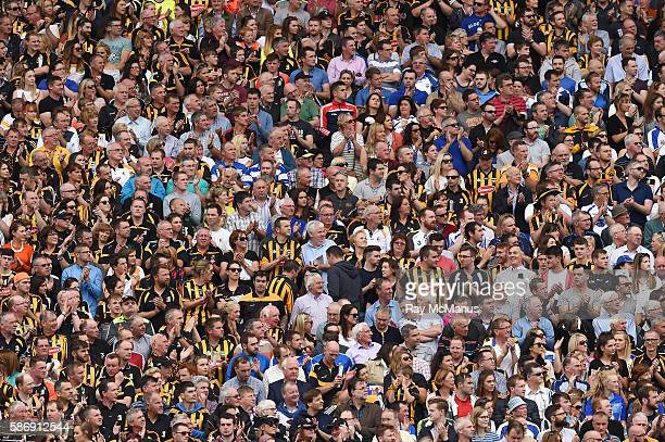 Dublin Ireland 7 August 2016 Supporters of both sides in the Hogan Stand applaud the life of the recently deceased Michael 'Ducksy' Walsh during a...