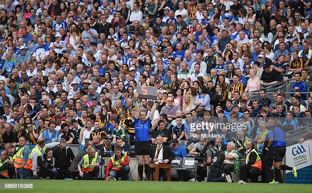 Dublin Ireland 7 August 2016 The sideline official Johnny Murphy holds a board indicating five minutes of added time at the end of the game during...
