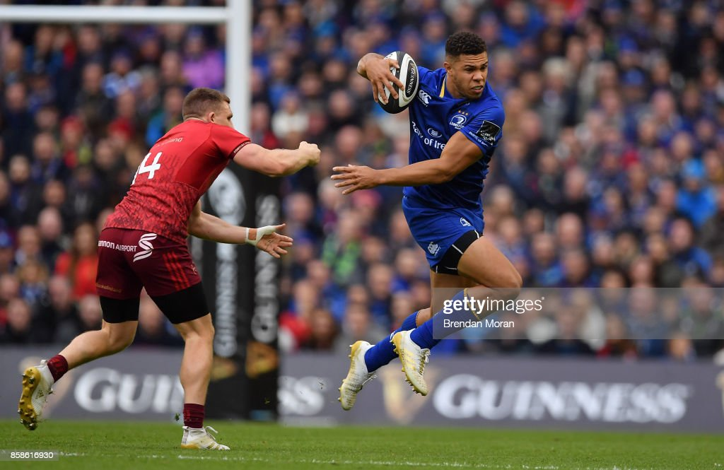 Dublin , Ireland - 7 October 2017; Adam Byrne of Leinster escapes the tackle of Andrew Conway of Munster during the Guinness PRO14 Round 6 match between Leinster and Munster at the Aviva Stadium in Dublin.