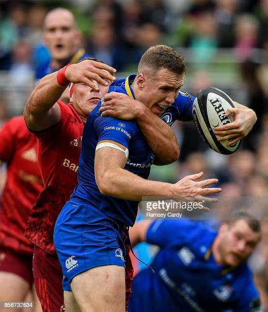 Dublin Ireland 7 October 2017 Rory O'Loughlin of Leinster is tackled by CJ Stander of Munster during the Guinness PRO14 Round 6 match between...