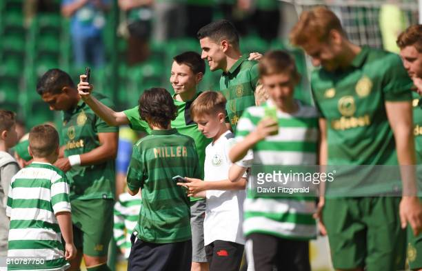 Dublin Ireland 8 July 2017 Tom Rogic centre stops for photos with fans following the friendly match between Shamrock Rovers and Glasgow Celtic at...