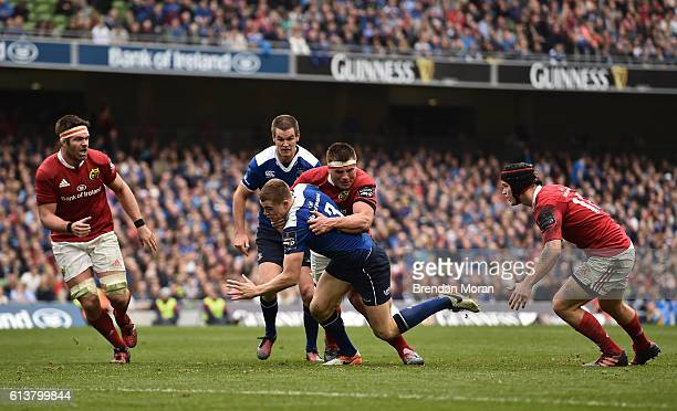 Dublin Ireland 8 October 2016 Garry Ringrose of Leinster is tackled by CJ Stander of Munster during the Guinness PRO12 Round 6 match between Leinster...