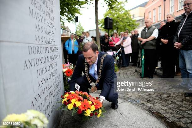 Dublin Lord Mayotr Naoise O Muiri lays a wreath during the annual wreath laying and memorial service for1974 the Dublin/Monaghan bombings victims at...