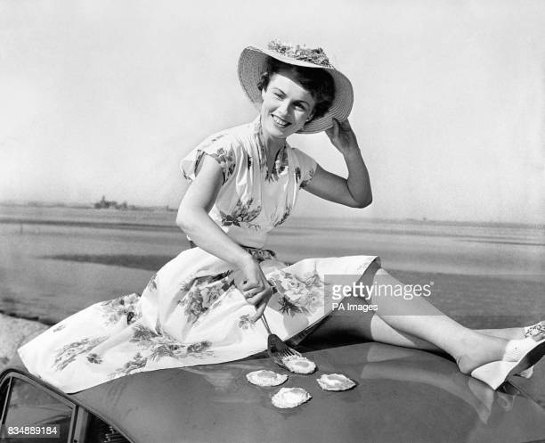 Dublin model Sheila McDonough takes advantage of the hot weather to fry eggs on the roof of her car at Seapoint County Dublin Ireland