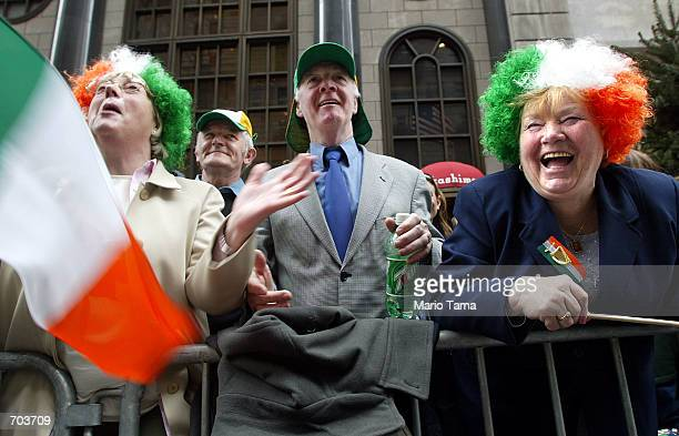 Dublin residents Antoinette Dunne Chris Finnegan and Christine Finnegan watch the annual St Patricks Day parade March 16 2002 in New York City A...
