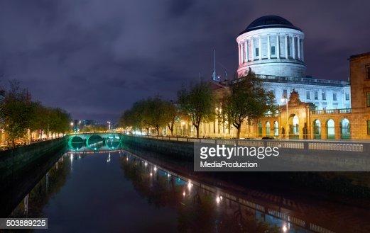 Dublin river liffey and court house illuminater at night