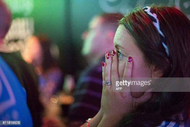 A Dublin supporter reacts as she watches GAA AllIreland Gaelic Football Final replay match between Dublin and Mayo in a city centre pub in Dublin...