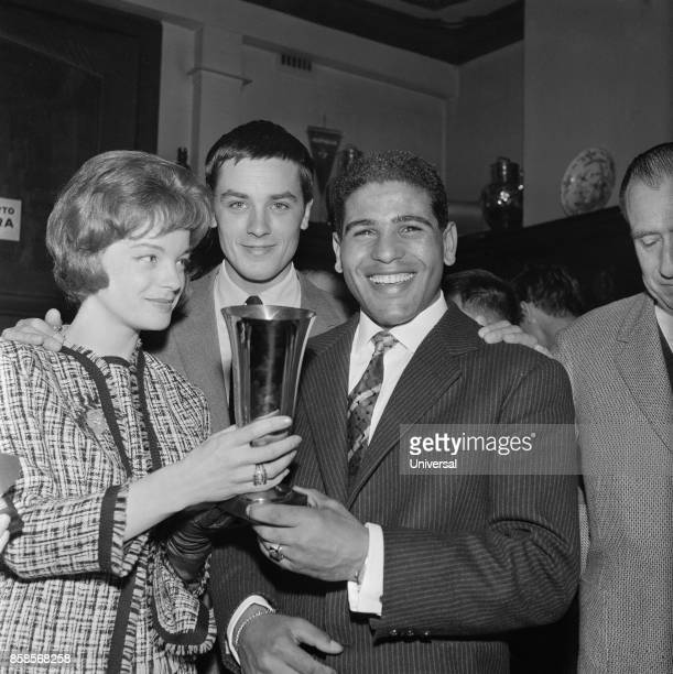 Dubonnet Oscars for boxers – Omrane Sadok hold the cup that he has just received He's surrounded by French actress Romy Schneider and the French...