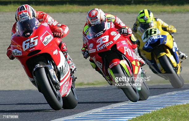 Ducati ace Loris Capirossi of Italy leads against fellow Italian Honda rider Marco Melandri and Valentino Rossi of Yamaha during the Japanese Grand...