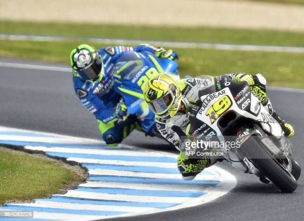 Ducati Aspar rider Alvaro Bautista of Spain and Suzuki rider Andrea Iannone of Italy negotiate a corner during the third practice session of the...